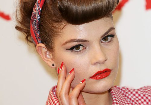 Retro style woman with red nails with minimalist detail on face