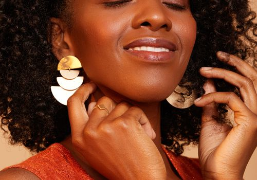 Black woman smiling with natural curly hair