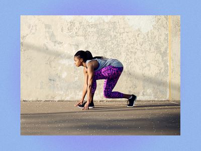 Woman crouching outside getting ready to work out