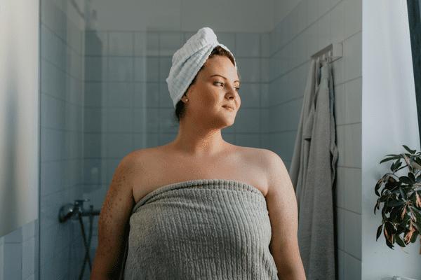 Woman standing near shower
