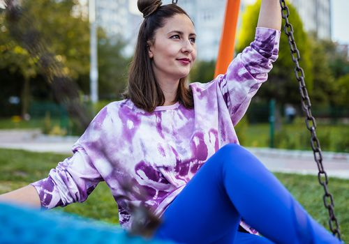Woman in sweatshirt at the park