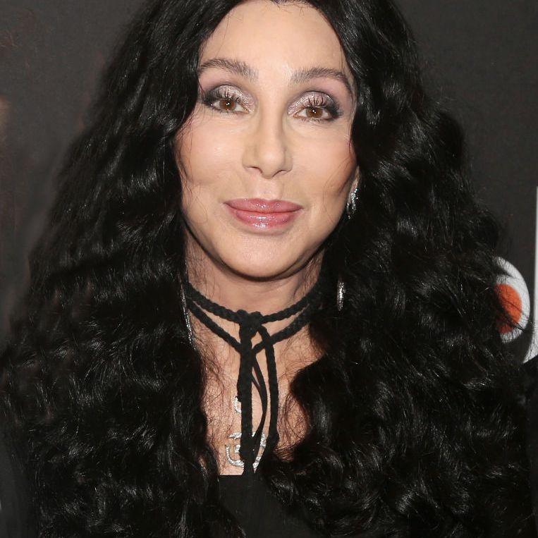 Cher long, curly black hair