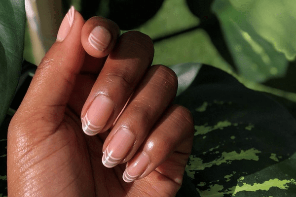 woman with clear manicure
