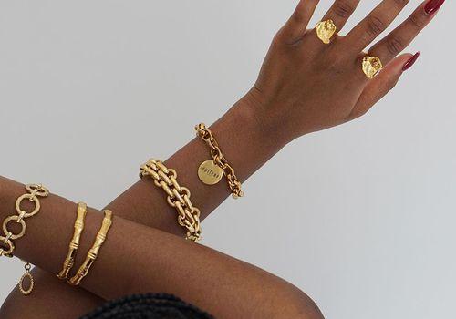 woman wearing gold jewelry