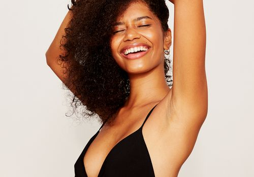 happy person with shaved armpits