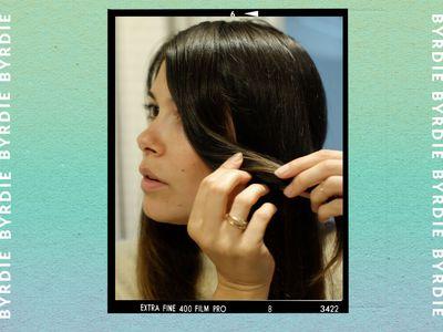 woman cutting face framing pieces