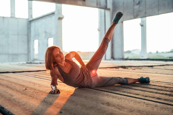 Woman performing a side leg lift