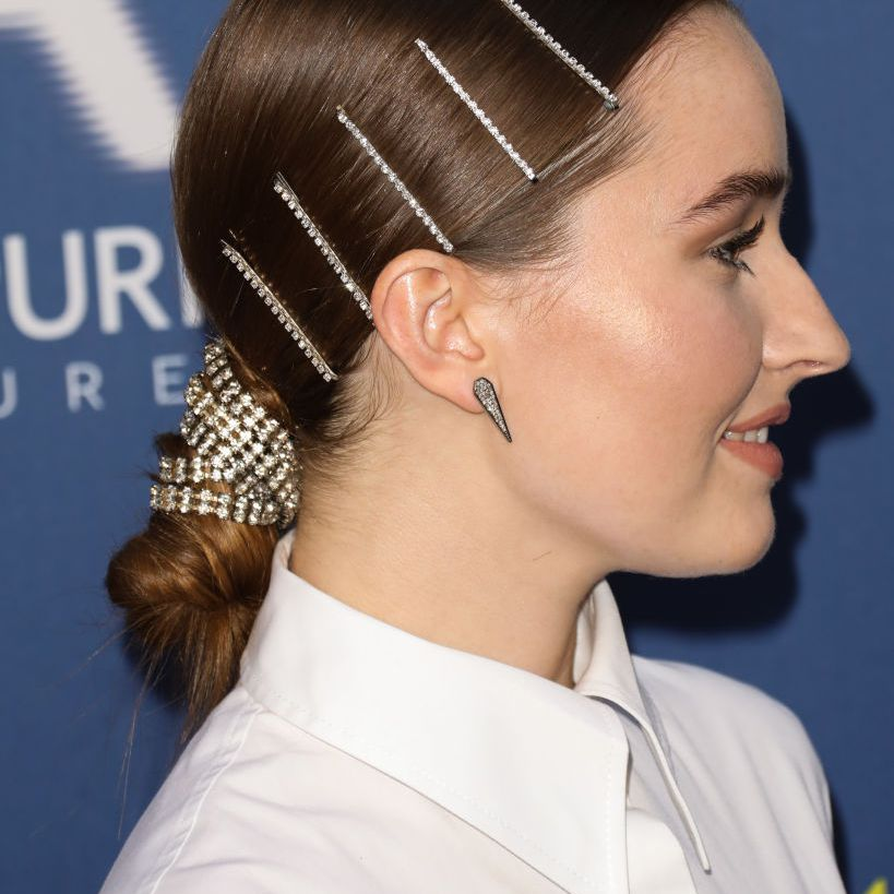 Kaitlyn Dever wearing a low bun hairstyle with hair accessories