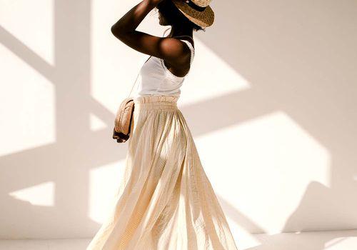 black femme in sunny studio