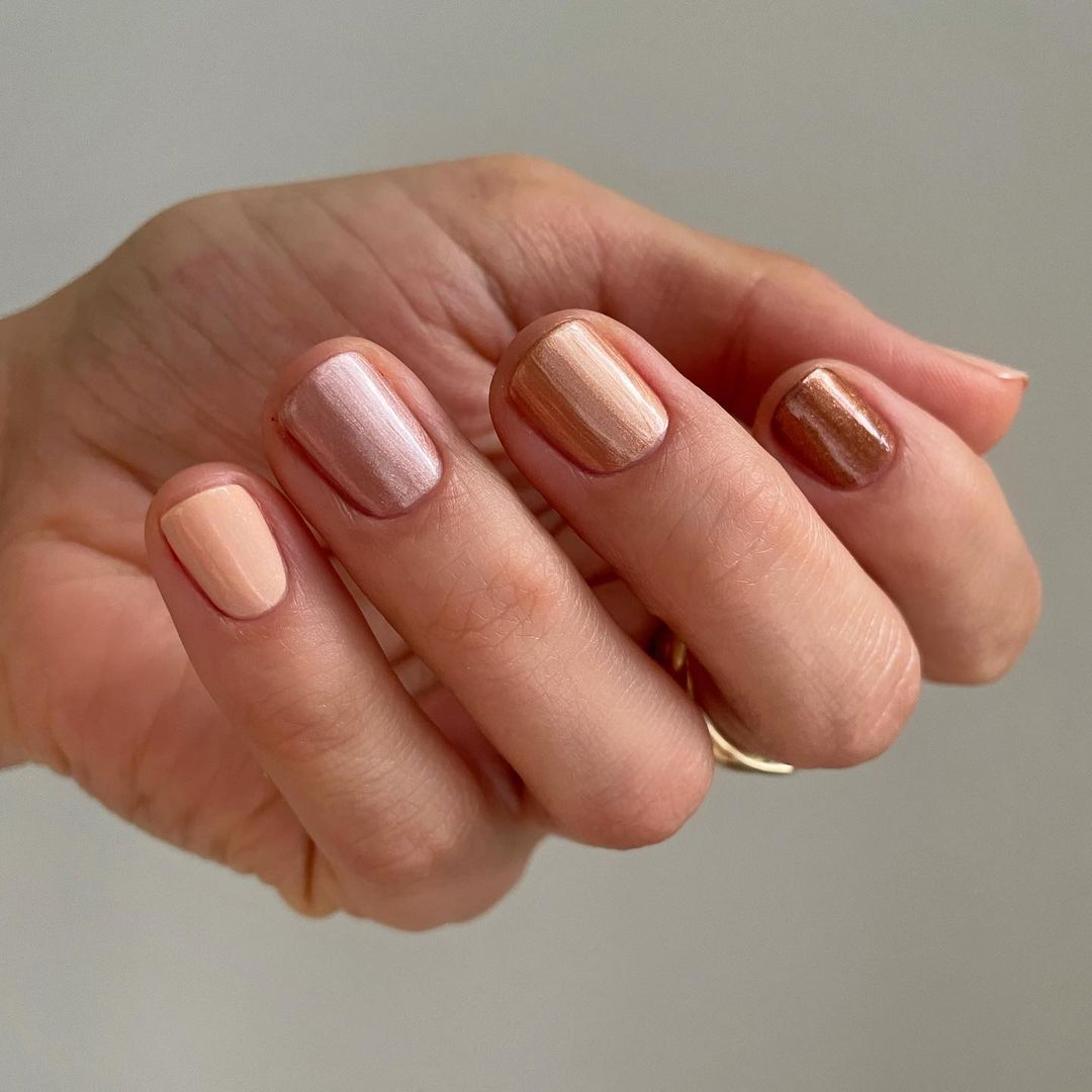 Person with neutral shimmer nails