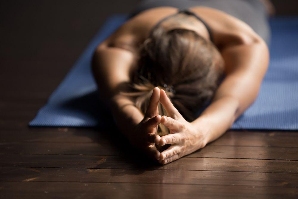 woman taking hot yoga class