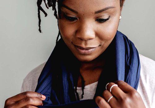 black femme wearing infinity scarf snood