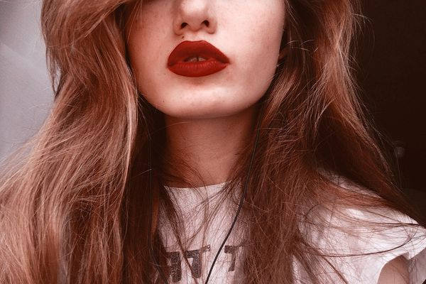 woman with thick eyebrows and red lipstick