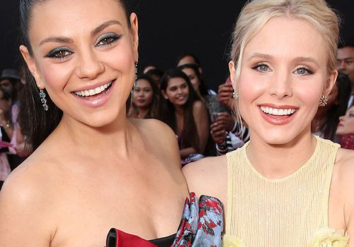 Mila Kunis and Kristen Bell on a red carpet