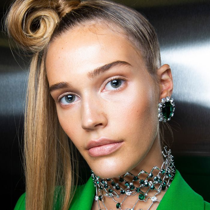 Model wearing her blonde hair in a futuristic ponytail