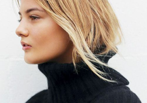 woman with blonde hair in turtleneck