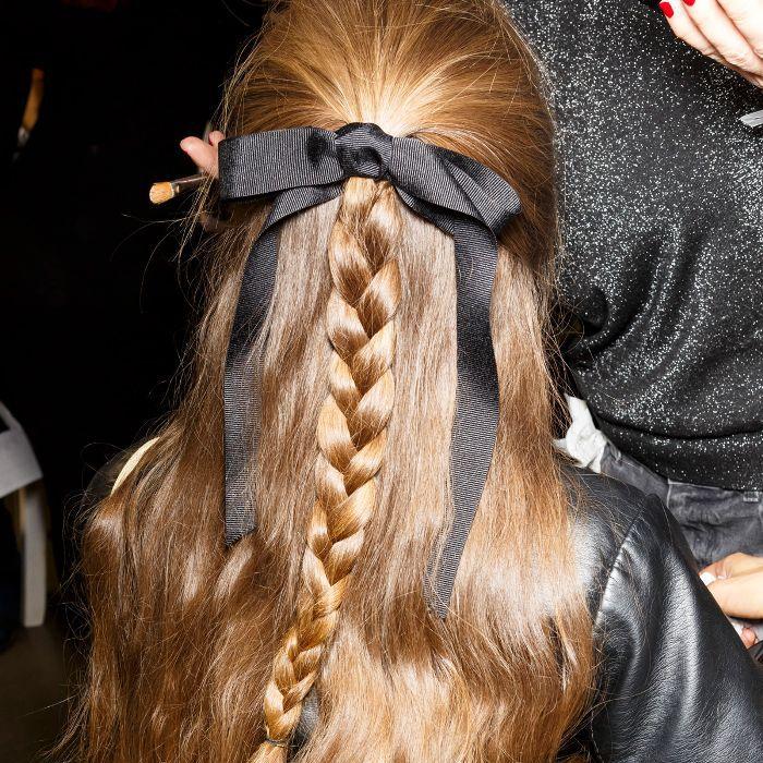 Hair pulled halfway back in a braid