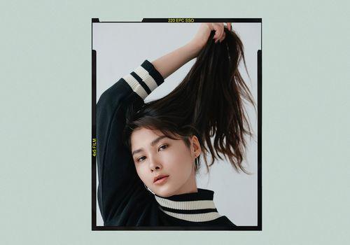 woman holding long hair upward
