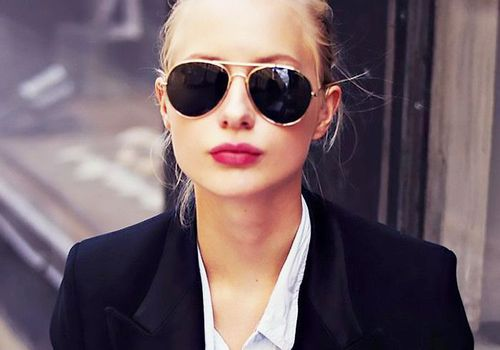 woman in sunglasses and red lipstick