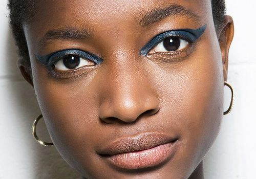 woman with blue winged eye makeup