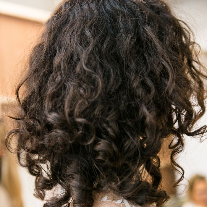 Model with dark curly hair