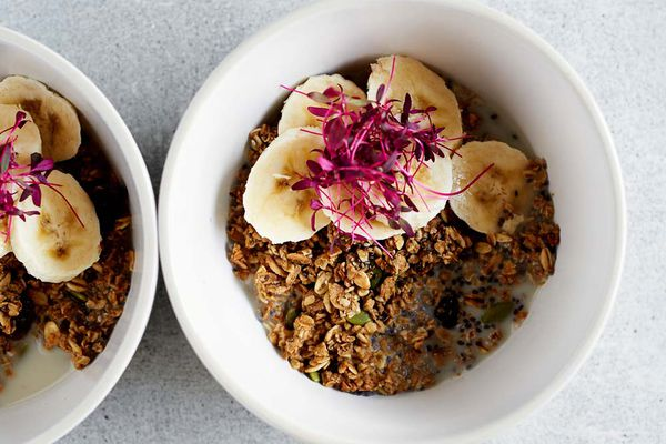 bowl granola bananas and flowers