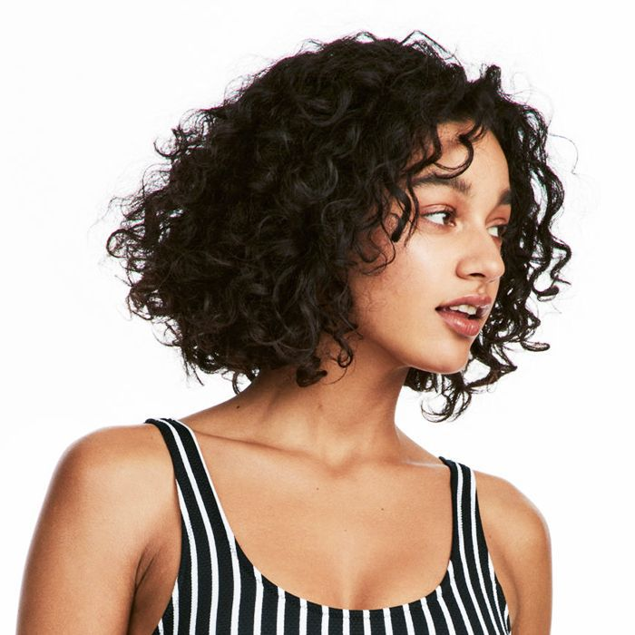Leave-in conditioners: woman with curly hair