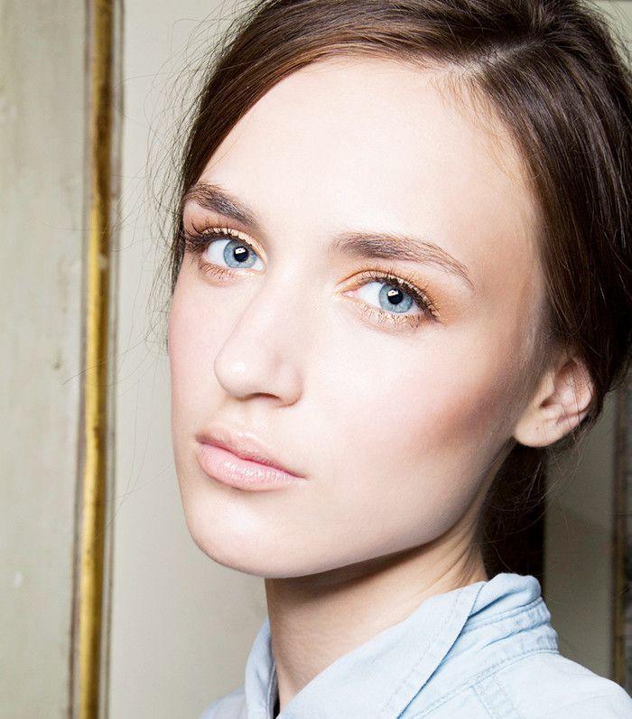 Model wearing rose gold eye makeup