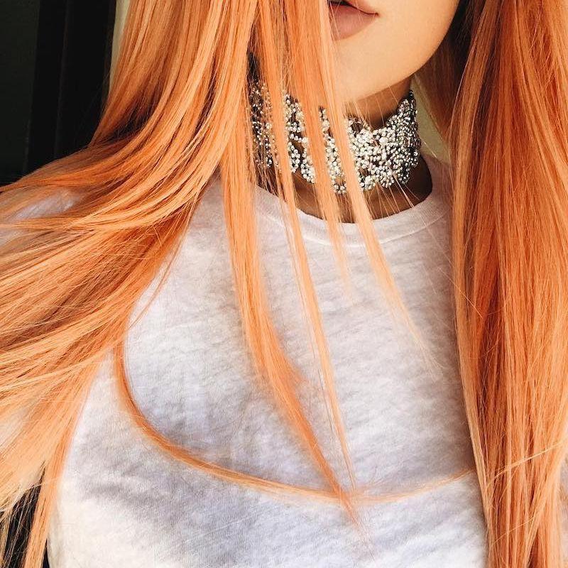 Kylie Jenner in peach orange wig