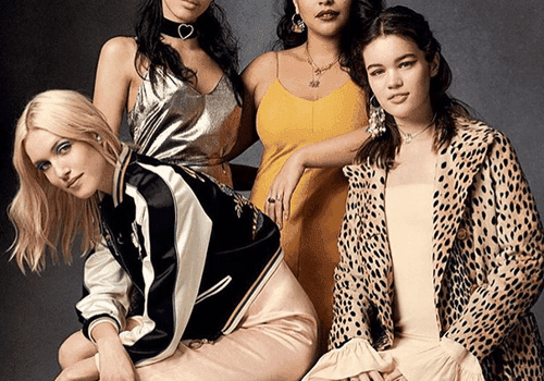 Four models standing and sitting