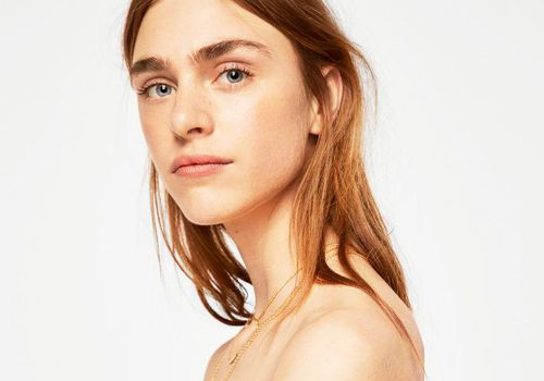 best fake tan for pale skin: woman with glowy skin