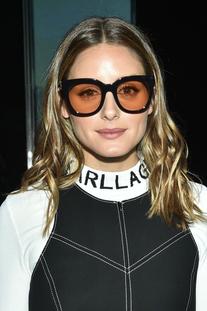 Olivia Palermo with tousled mid-length hair and sunglasses