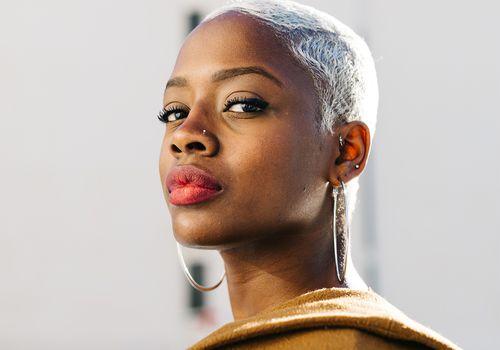 portrait of black femme in the light