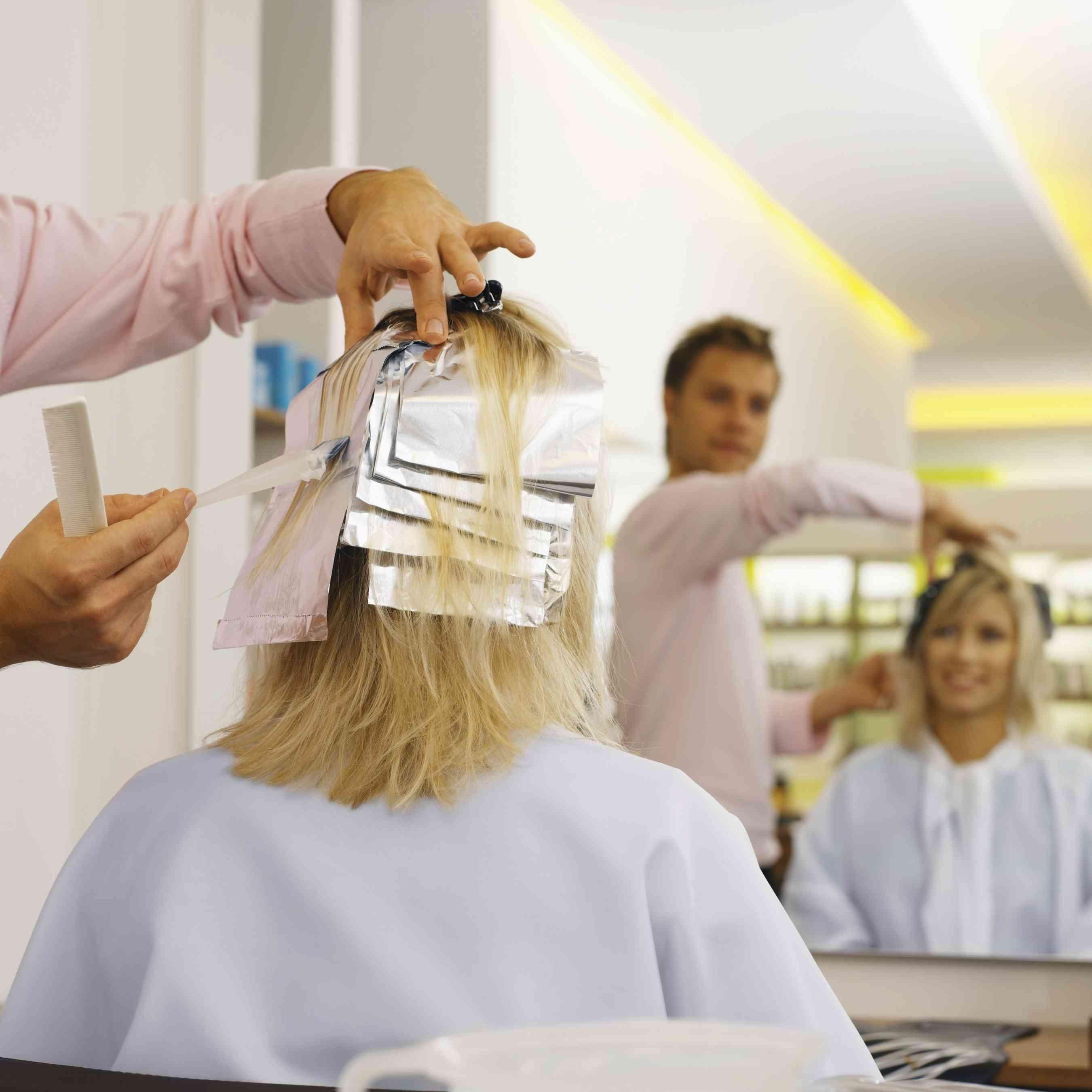 Woman getting highlights at a salon