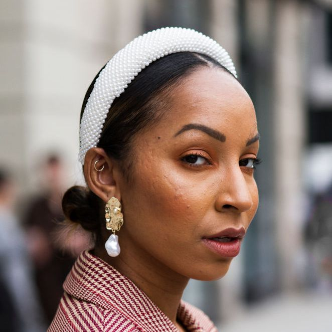 woman wearing a headband with center part