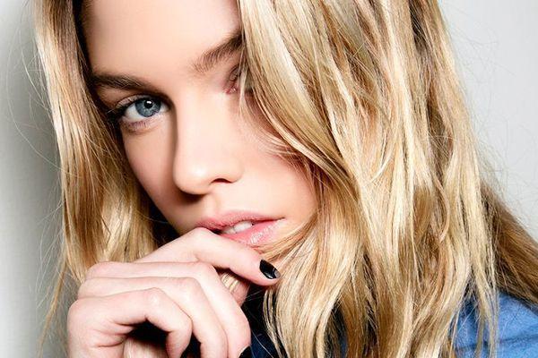 Blonde woman with black nail polish