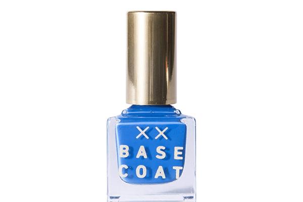 Bottle of bright blue nail polish on white background.
