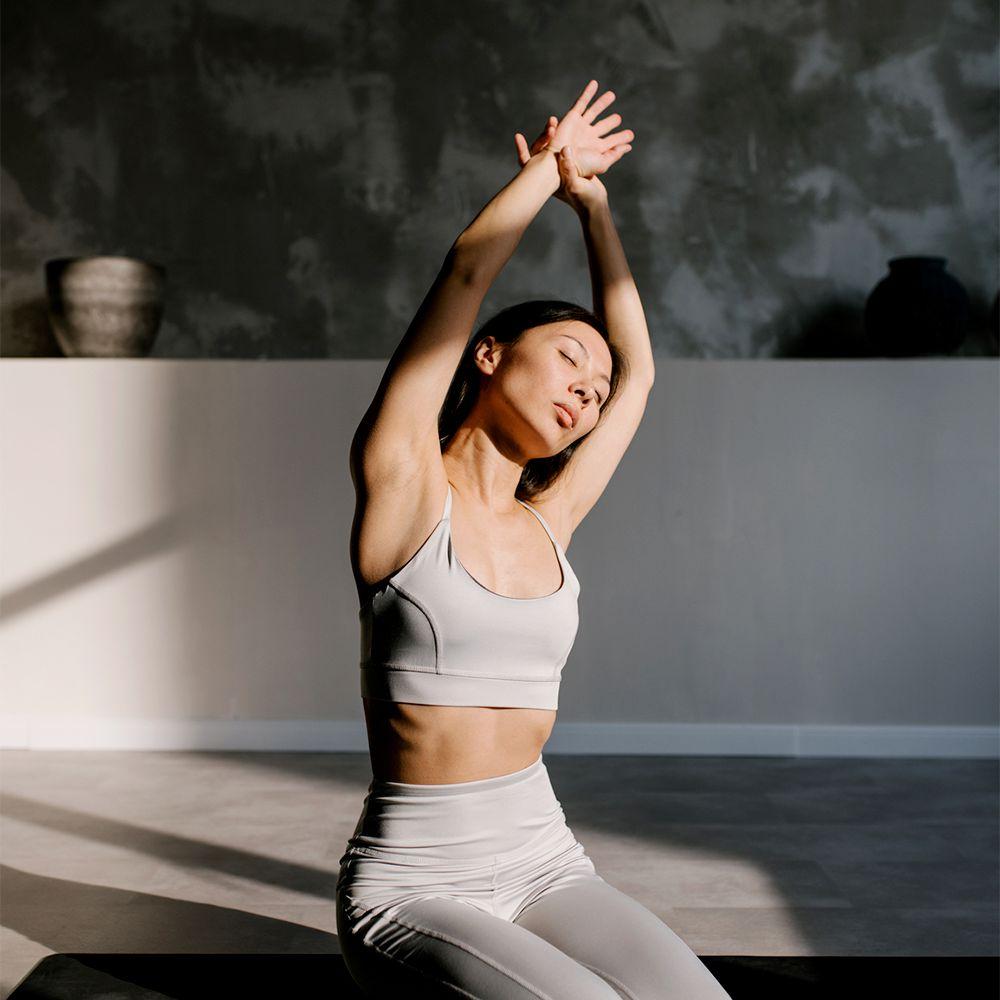 person doing yoga inside studio