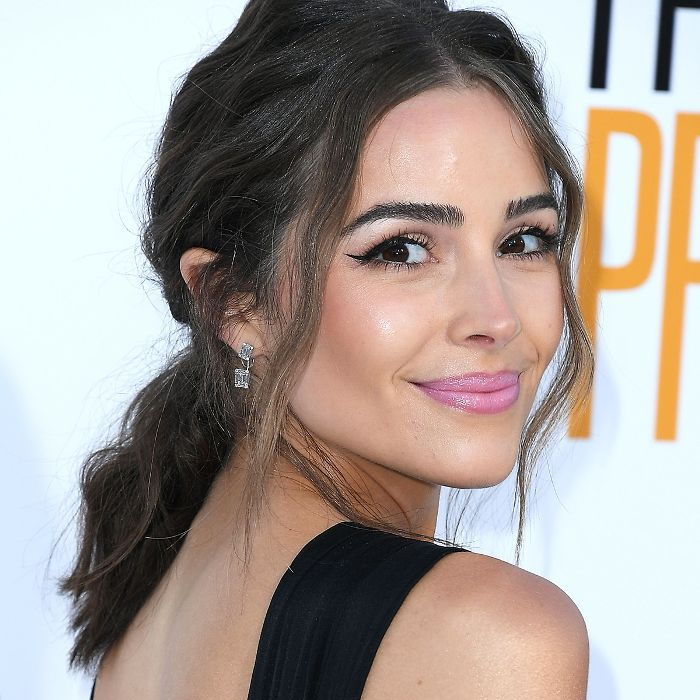 Olivia Culpo with a low, messy ponytail