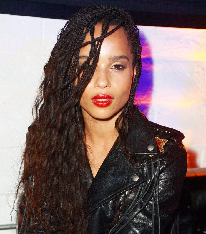 Zoe Kravitz wearing red lipstick and a leather jacket