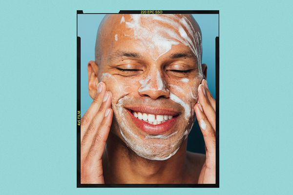 Man washing his face with foam cleanser