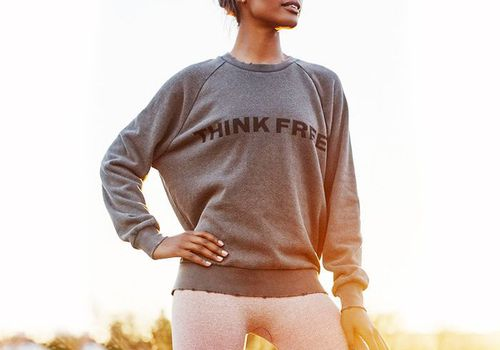 woman standing proud with think free tee shirt