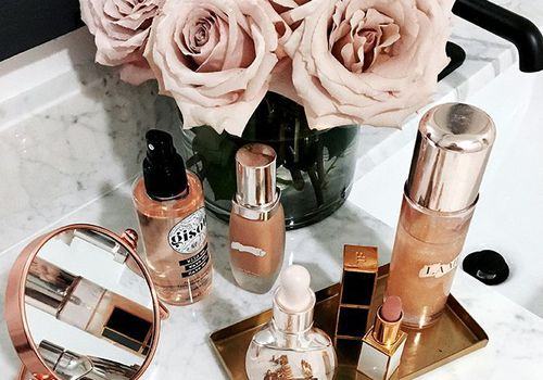 beauty products spread out with roses