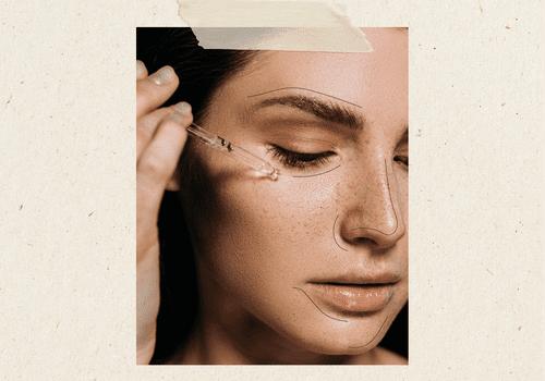 woman applying serum to her cheek