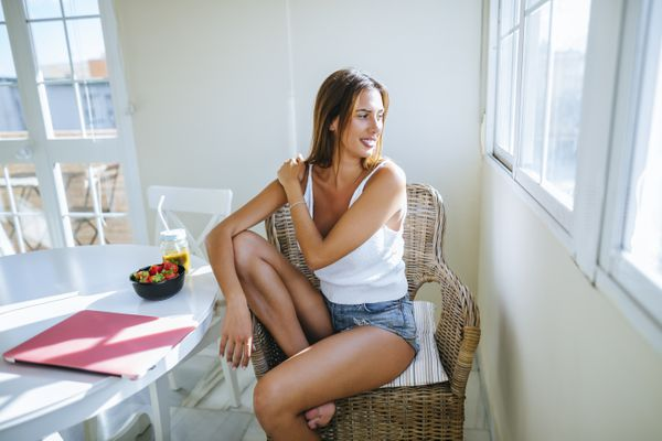 woman with a tan in her kitchen