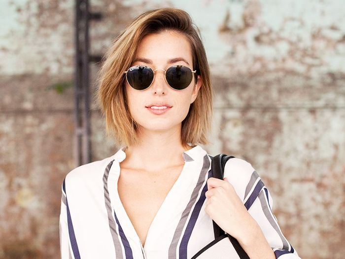 Girl with short blonde haircut wearing sunglasses