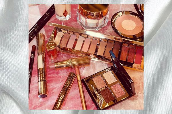 charlotte tilbury products on pink background
