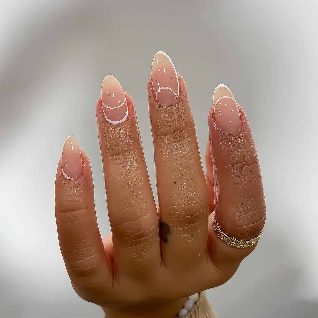 Person with inverted negative space nail art