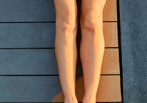 Woman with smooth legs and bikini wax