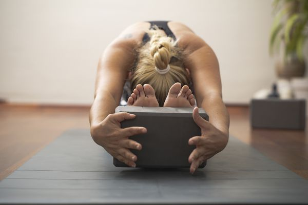 Woman with yoga block
